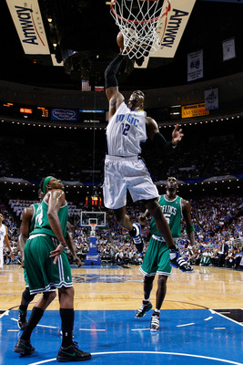 ORLANDO, FL - MAY 26:  Dwight Howard #12 of the Orlando Magic dunks against Paul Pierce #34 and Kevin Garnett #5 of the Boston Celtics in Game Five of the Eastern Conference Finals during the 2010 NBA Playoffs at Amway Arena on May 26, 2010 in Orlando, Fl