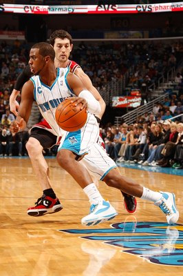 NEW ORLEANS - JANUARY 29:  Chris Paul #3 of the New Orleans Hornets drives the ball around Kirk Hinrich #12 of the Chicago Bulls at the New Orleans Arena on January 29, 2010 in New Orleans, Louisiana.   NOTE TO USER: User expressly acknowledges and agrees