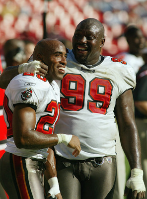 Big and small - Warren Sapp and Rhonde Barber having fun on any given Sunday in 2002