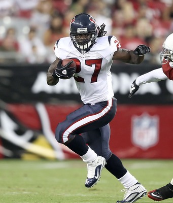 GLENDALE, AZ - AUGUST 14:  Runningback Chris Henry #27 of the Houston Texans rushes the ball past Hamza Abdullah #41 of the Arizona Cardinals during preseason NFL game at the University of Phoenix Stadium on August 14, 2010 in Glendale, Arizona. The Cardi