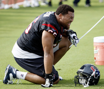 HOUSTON - JULY 31:  Defensive tackle DelJuan Robinson #66 takes a water break during practice on July 31, 2009 in Houston, Texas. Temperatures in southeast Texas once again reached at-least 100 degrees.   (Photo by Bob Levey/Getty Images)