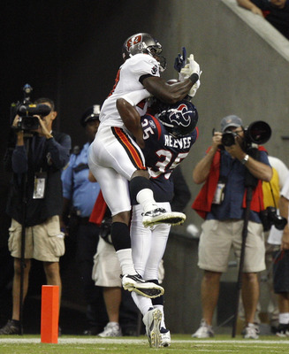 HOUSTON - SEPTEMBER 02:  Wide receiver Arrelious Benn #17 of the Tampa Bay Buccaneers leaps over cornerback Jacques Reeves #35 of the Houston Texans for a touchdown in the fourth quarter at Reliant Stadium on September 2, 2010 in Houston, Texas.  (Photo b
