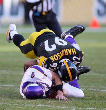 PITTSBURGH - OCTOBER 25:  Brett Favre #4  of the Minnesota Vikings is sacked on the last play of the game by James Harrison #92  of the Pittsburgh Steelers at Heinz Field on October 25, 2009 in Pittsburgh, Pennsylvania. Pittsburgh won 27-17. (Photo by Ric