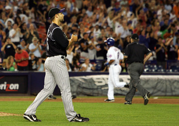 NEW YORK - JULY 11:  Taylor Buchholz #35 of the Colorado Rockies looks on after surrendering an eighth inning home run to Damion Easley #3 on July 11, 2008 at Shea Stadium in the Flushing neighborhood of the Queens borough of New York City.  (Photo by Jim