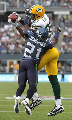 SEATTLE - AUGUST 21:  Tight end Jermichael Finley #88 of the Green Bay Packers makes a catch during the preseason game against Kelly Jennings #21of the Seattle Seahawks at Qwest Field on August 21, 2010 in Seattle, Washington. (Photo by Otto Greule Jr/Get
