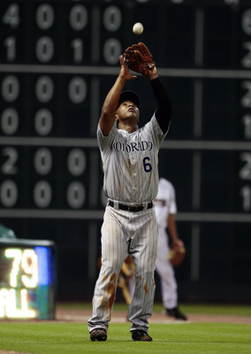 HOUSTON - MAY 19:  Third baseman Melvin Mora #6 of the Colorado Rockies makes a catch in foul territory against the Houston Astros at Minute Maid Park on May 19, 2010 in Houston, Texas.  (Photo by Bob Levey/Getty Images)