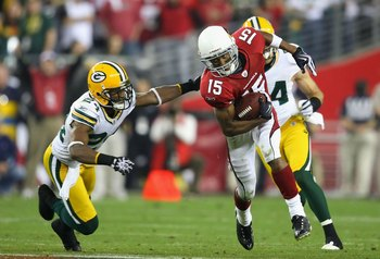 GLENDALE, AZ - JANUARY 10:  Wide receiver Steve Breaston #15 of the Arizona Cardinals runs with the ball past Jarrett Bush #24 of the Green Bay Packers during the 2010 NFC wild-card playoff game at the Universtity of Phoenix Stadium on January 10, 2010 in