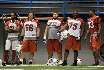 FLAGSTAFF, AZ - AUGUST 02:  (L-R) Larry Fitzgerald #11, Alan Faneca #66, Deuce Lutui #76, Levi Brown #75 and Dan Williams #93 of the Arizona Cardinals practice in the team training camp at Northern Arizona University Walkup Skydome on August 2, 2010 in Fl