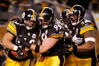 PITTSBURGH - JANUARY 18:  Safety Troy Polamalu #43 of the Pittsburgh Steelers celebrates his touchdown with defensive end Brett Keisel #99, safety Tyrone Carter #23 and linebacker LaMarr Woodley #56 against the Baltimore Ravens during the fourth quarter o