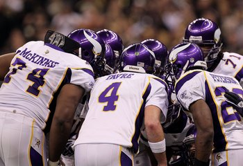 NEW ORLEANS - JANUARY 24:  (L-R) Bryant McKinnie #74, Brett Favre #4 and Adrian Peterson #28 of the Minnesota Vikings stand in the offensive huddle against the New Orleans Saints during the NFC Championship Game at the Louisiana Superdome on January 24, 2