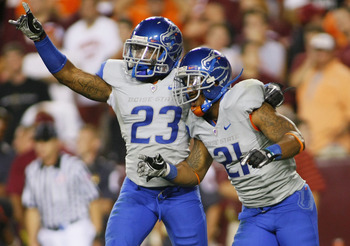LANDOVER, MD - SEPTEMBER 06:  Safety #23 Jeron Johnson of and cornerback #21 Jamar Taylor of the Boise State Broncos celebrate defeating the Virginia Tech Hokies 33-30 at FedExField on September 6, 2010 in Landover, Maryland.  (Photo by Geoff Burke/Getty