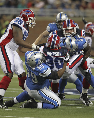 DETROIT - SEPTEMBER 02: Jaron Baston #69 and Ashlee Palmer #58 of the Detroit Lions make the stop on Chad Simpson #30 of the Buffalo Bills during the preseason game at Ford Field on September 2, 2010 in Detroit, Michigan.  (Photo by Leon Halip/Getty Image