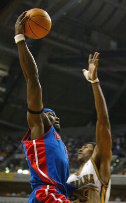 INDIANAPOLIS - MAY 24:  Ben Wallace #3 of the Detroit Pistons goes up for a basket over Ron Artest #23 of the Indiana Pacers in Game two of the Eastern Conference Finals during the 2004 NBA Playoffs at Conseco Fieldhouse on May 24, 2004 in Indianapolis, I