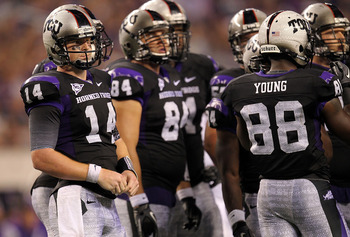 TCU quarterback Andy Dalton awaits call from the sideline against Oregon State