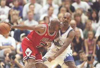 8 Jun 1997:  Guard Michael Jordan of the Chicago Bulls tries to drive past forward Bryon Russell of the Utah Jazz during a playoff game at the Delta Center in Salt Lake City, Utah.  The Jazz won the game 78-73.   Mandatory Credit: Brian Bahr  /Allsport