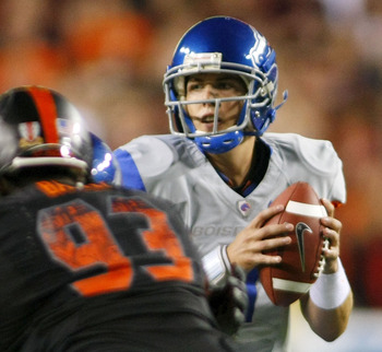 Kellen Moore looks to fire over Virginia Tech's defensive line
