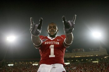 HOUSTON - SEPTEMBER 26: A.J. Dugat of the Houston Cougars celebrates the UH win against Texas Tech Red Raiders at Robertson Stadium on September 26, 2009 in Houston, Texas.  (Photo by Thomas B. Shea/Getty Images)