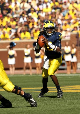 ANN ARBOR, MI - SEPTEMBER 19:  Quarterback Denard Robinson #16 of the Michigan Wolverines drops back to pass against the Eastern Michigan Eagles at Michigan Stadium on September 19, 2009 in Ann Arbor, Michigan.  Michigan won 45-17.  (Photo by Stephen Dunn