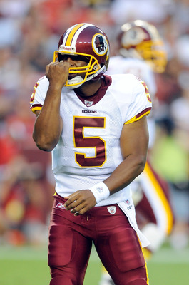 LANDOVER, MD - AUGUST 13:  Donovan McNabb #5 of the Washington Redskins motions for a facemask call during the preseason game against the Buffalo Bills at FedEx Field on August 13, 2010 in Landover, Maryland.  (Photo by Greg Fiume/Getty Images)