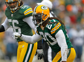 GREEN BAY, WI - DECEMBER 27: Atari Bigby #20 of the Green Bay Packers celebrates one of his two interceptions against the Seattle Seahawks at Lambeau Field on December 27, 2009 in Green Bay, Wisconsin. The Packers defeated the Seahawks 48-10. (Photo by Jo