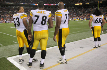 DENVER - AUGUST 29:  Offensive linemen Maurkice Pouncey #53, Max Starks #78, Flozell Adams #71 and Chris Kemoeatu #68 of the Pittsburgh Steelers watch from the sideline as they prepare for action against the Denver Broncos during preseason NFL action at I