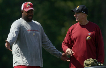 ASHBURN, VA - JULY 30:  Defensive lineman Albert Haynesworth #92 of the Washington Redskins works out with defensive coordinator Jim Haslett (R) following practice on the second day of training camp July 30, 2010 in Ashburn, Virginia. Haynesworth failed a