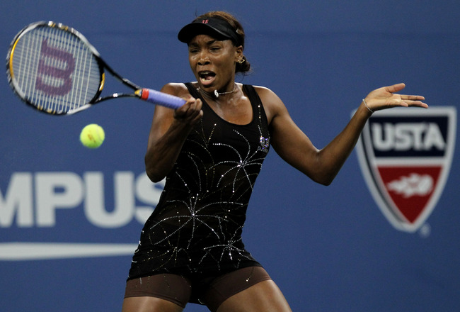 NEW YORK - SEPTEMBER 03:  Venus Williams returns a shot against Mandy Minella of Luxembourg (not pictured) during day five of the 2010 U.S. Open at the USTA Billie Jean King National Tennis Center on September 3, 2010 in the Flushing neighborhood of the Q