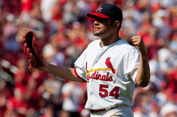 ST. LOUIS - AUGUST 22: Starter Jaime Garcia  #54 of the St. Louis Cardinals celebrates his three-hit game against the San Francisco Giants at Busch Stadium on August 22, 2010 in St. Louis, Missouri.  (Photo by Dilip Vishwanat/Getty Images)