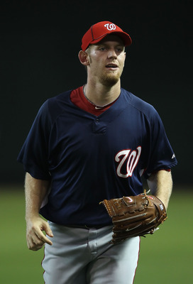 PHOENIX - AUGUST 04:  Pitcher Stephen Strasburg #37 of the Washington Nationals warms up in the outfield before the Major League Baseball game against the Arizona Diamondbacks at Chase Field on August 4, 2010 in Phoenix, Arizona. The Nationals defeated th