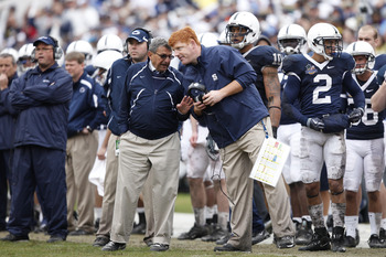 ORLANDO, FL - JANUARY 1: Head coach Joe Paterno of the Penn State Nittany Lions talks with offensive assistant coach Mike McQueary during the 2010 Capital One Bowl against the LSU Tigers at the Florida Citrus Bowl Stadium on January 1, 2010 in Orlando, Fl