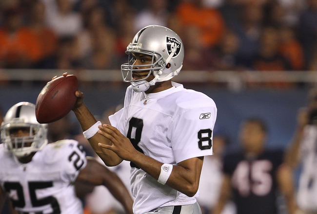 CHICAGO - AUGUST 21: Jason Campbell #8 of the Oakland Raiders looks for a receiver against the Chicago Bears during a preseason game at Soldier Field on August 21, 2010 in Chicago, Illinois. (Photo by Jonathan Daniel/Getty Images)