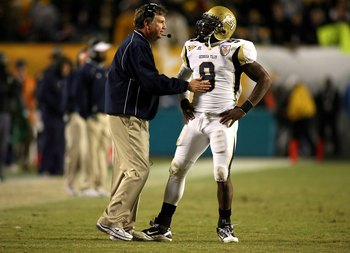 MIAMI GARDENS, FL - JANUARY 05:  Head coach Paul Johnson of the Georgia Tech Yellow Jackets talks with quarterback Josh Nesbitt #9 against the Iowa Hawkeyes during the FedEx Orange Bowl at Land Shark Stadium on January 5, 2010 in Miami Gardens, Florida.