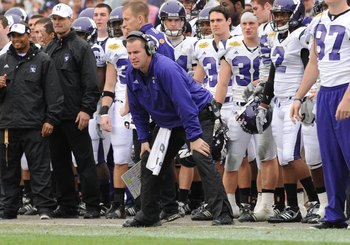 TAMPA, FL - JANUARY 1: Coach Pat Fitzgerald of the Northwestern Wildcats directs play against the Auburn Tigers in the Outback Bowl January 1, 2010 at Raymond James Stadium in Tampa, Florida.  (Photo by Al Messerschmidt/Getty Images)