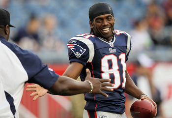 FOXBORO, MA - AUGUST 12: Randy Moss #81 of the New England Patriots smiles before the preseason game against the New Orleans Saints at Gillette Stadium on August 12, 2010 in Foxboro, Massachusetts. (Photo by Jim Rogash/Getty Images)