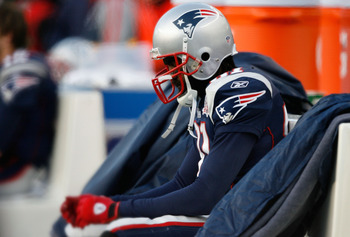 FOXBORO, MA - JANUARY 10:  Randy Moss #81 of the New England Patriots sits on the bench dejected late in the fourth quarter against the Baltimore Ravens during the 2010 AFC wild-card playoff game at Gillette Stadium on January 10, 2010 in Foxboro, Massach