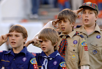 Scouts of all sizes salute during the Pledge of Allegiance before  the 2005 Champs Sports Bowl December 27 in Orlando.  Clemson defeated Colorado 19 - 10. (Photo by A. Messerschmidt/Getty Images) *** Local Caption ***