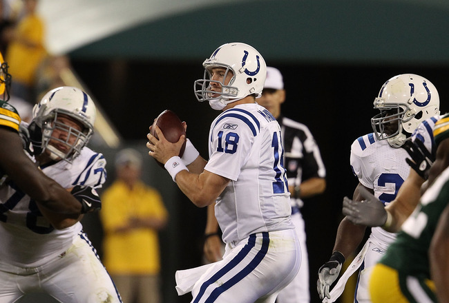 GREEN BAY, WI - AUGUST 26: Peyton Manning #18 of the Indianapolis Colts drops back to pass against the Green Bay Packers during a preseason game at Lambeau Field on August 26, 2010 in Green Bay, Wisconsin.  The Packers defeated the Colts 59-24.  (Photo by