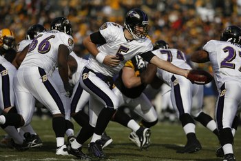 PITTSBURGH - DECEMBER 27:  Joe Flacco #5 of the Baltimore Ravens hands off during the game against the Pittsburgh Steelers on December 27, 2009 at Heinz Field in Pittsburgh, Pennsylvania. (Photo by Gregory Shamus/Getty Images)