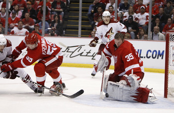 DETROIT - APRIL 20:  Jimmy Howard #35 of the Detroit Red Wings makes a save without his goalie mask behind teammate Niklas Kronwall #55 and Lee Stempniak #22 of the Phoenix Coyotes during Game Four of the Western Conference Quarterfinals of the 2010 NHL S