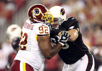 GLENDALE, AZ - SEPTEMBER 02:  Defensive tackle Albert Haynesworth #92 of the Washington Redskins battles for position with Alan Faneca #66 of the Arizona Cardinals during preseason NFL game at the University of Phoenix Stadium on September 2, 2010 in Glen