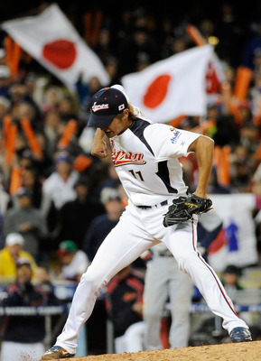 LOS ANGELES, CA - MARCH 22:  Pitcher Yu Darvish #11 of Japan celebrates after striking out Adam Dunn #17 of the United States to win the semifinal game of the 2009 World Baseball Classic on March 22, 2009 at Dodger Stadium in Los Angeles, California. Japa