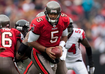 TAMPA, FL - JANUARY 03:  Quarterback Josh Freeman #5 of the Tampa Bay Buccaneers hands the ball off against the Atlanta Falcons during the game at Raymond James Stadium on January 3, 2010 in Tampa, Florida.  (Photo by J. Meric/Getty Images)
