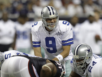 HOUSTON - AUGUST 28: Quarterback Tony Romo #9 of the Dallas Cowboys calls out a play at the line of scrimmage during a football game against the Houston Texans at Reliant Stadium on August 28, 2010 in Houston, Texas. Houston won 23-7. (Photo by Bob Levey/
