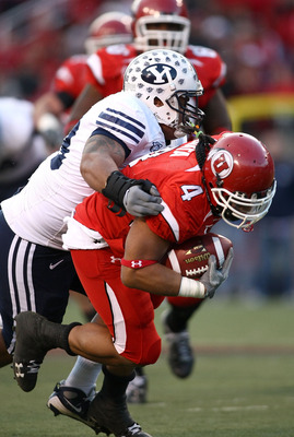 SALT LAKE CITY - NOVEMBER 22:  Matt Asiata #4 of the Utah Utes runs with the ball against the BYU Cougars at Rice-Eccles Stadium on November 22, 2008 in Salt Lake City, Utah.  (Photo by Jonathan Ferrey/Getty Images)