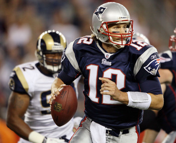 FOXBORO, MA - AUGUST 26:  Tom Brady #12 of the New England Patriots scrambles in the first half against the St. Louis Rams on August 26, 2010 at Gillette Stadium in Foxboro, Massachusetts.  (Photo by Elsa/Getty Images)
