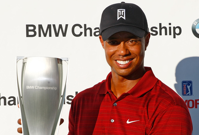 LEMONT, IL - SEPTEMBER 13:  Tiger Woods poses with the trophy after his eight-stroke victory at the BMW Championship held at Cog Hill Golf & CC on September 13, 2009 in Lemont, Illinois.  (Photo by Scott Halleran/Getty Images)