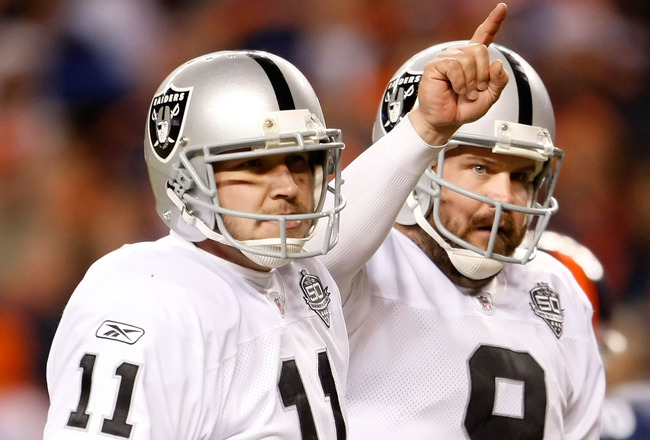 DENVER - DECEMBER 20:  Sebastian Janikowski #11 and Shane Lechler #9 of the Oakland Raiders celebrate the extra point after Chaz Schilens' touchdown in the fourth quarter against the Denver Broncos at Invesco Field at Mile High on December 20, 2009 in Den