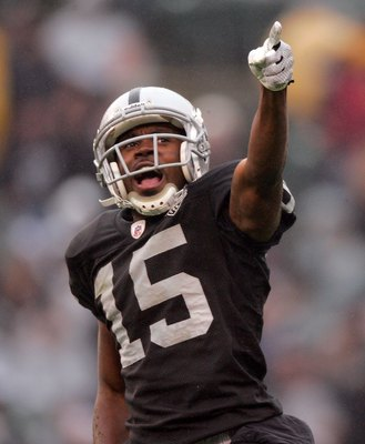 OAKLAND, CA - DECEMBER 13:  Johnnie Lee Higgins #15 of the Oakland Raiders reacts during their game against the Washington Redskins at Oakland-Alameda County Coliseum on December 13, 2009 in Oakland, California.  (Photo by Ezra Shaw/Getty Images)