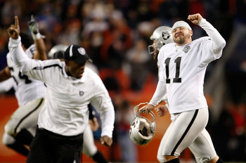 DENVER - DECEMBER 20:  Sebastian Janikowski (R) #11 of the Oakland Raiders celebrates a victory over the Denver Broncos at Invesco Field at Mile High on December 20, 2009 in Denver, Colorado. The Raiders defeated the Broncos 20-19.  (Photo by Jeff Gross/G