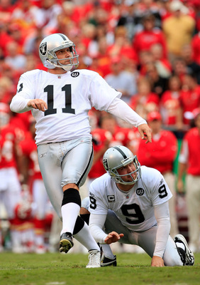 KANSAS CITY, MO - SEPTEMBER 14:  Kicker Sebastian Jankikowski #11 of the Oakland Raiders watches a field goal with holder Shane Lechler #9 during the first half fo the game against the Kansas City Chiefs on September 14, 2008 at Arrowhead Stadium in Kansa